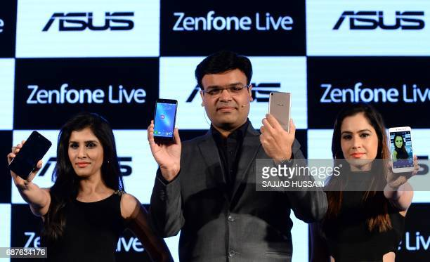 Indian Director of the Mobile Product Centre for systems business group Asus India Dinesh Sharma poses for a photograph during the launch of the Asus...