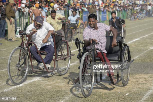 Indian disabled competitors take part in a tricycle race during the last day of the Kila Raipur Games popularly known as the Rural Olympics at Kila...