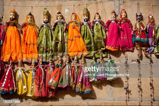 Indian dolls hanging on wall : Stock Photo