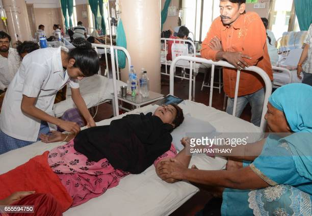 Indian domestic worker Hafijabanu Rajabhusen is treated at a hospital following her return from Saudi Arabia in Ahmedabad on March 20 2017...