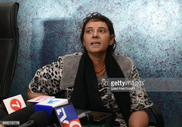 Indian domestic worker Hafijabanu Rajabhusen speaks to the media at a press conference following her return from Saudi Arabia in Ahmedabad on March...