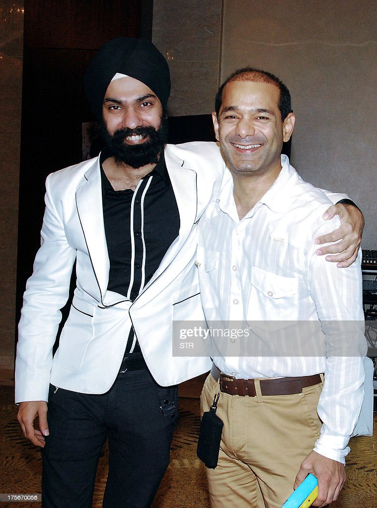 Indian dress designers, AD Singh (L) and Jatin Kochharthe pose at the 'Signature Premier Pune Style Week 2013' press conference announcing the three day fashion festival in Pune on August 5, 2013.