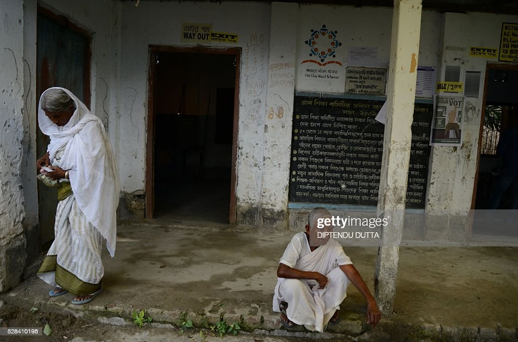 Indian elderly citizens of Masaladanga enclave leave after casting their ballots for the first time at a polling station in Cooch Behar district on May 5, 2016,during the final phase of state assembly elections in the eastern Indian state of West Bengal. The pair were among many who became Indian citizens after a transfer of enclaves between India and Bangladesh in 2015, when India and Bangladesh signed a Land Boundary Agreement. Under the agreement Bangladesh had transferred 51 enclaves to India while India transferred 111 to Bangladesh / AFP / DIPTENDU