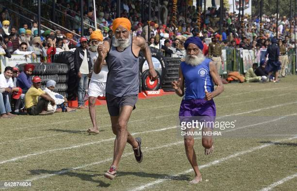 Indian elderly competitors take part in a running race for the over 70s during the last day of the Kila Raipur Games popularly known as the Rural...