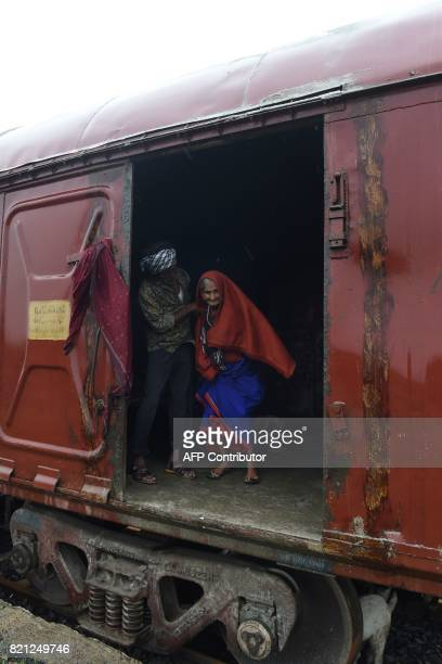 Indian elderly woman Bachiben Katia some 105 year old is helped by her 65 year old SoninLaw Jummabhai Jeda as they take refuge in a railway...