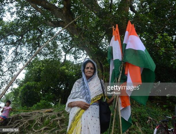 Indian elderly woman holds national flag during the Independence Day celebration in Shivnibas Nadia district 95 km from Kolkata India on Friday 18th...