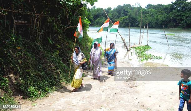 Indian elderly women holds national flag during the Independence Day celebration in Shivnibas Nadia district 95 km from Kolkata India on Friday 18th...