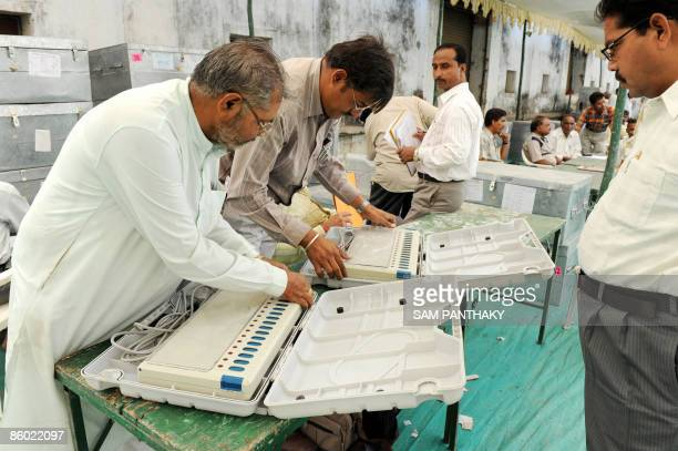 Indian election officials check Electronic Voting Machines in Ahmedabad on April 18 for distribution across Gujarat state polling districts of...