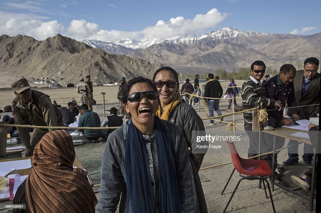 Indian election workers laugh while check voting machines before leaving a central collection point for polling stations, on May 6, 2014 in Leh, Ladakh, India. India is in the midst of a nine phase election that began on April 7th and ends on May 12th. Ladakh voters will vote on May 7th.