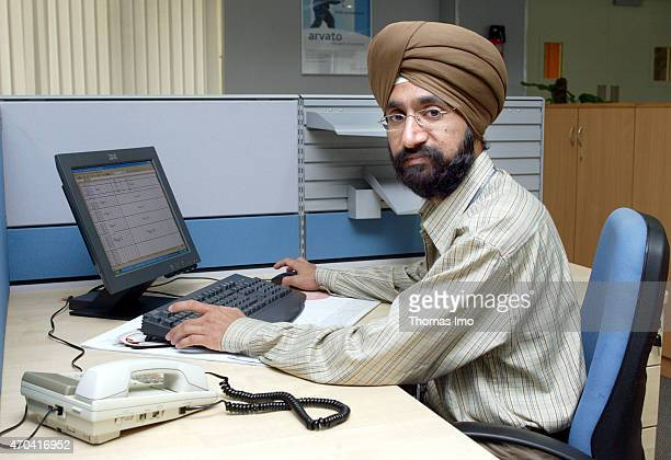 Indian employee of the Arvato Services a joint venture between Bertelsmann Group and the Indian Bird Group at a computer desk on March 22 2004 in New...