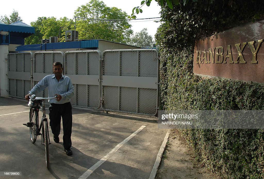 Indian employee of the Ranbaxy Laboratories Limited pharmaceutical Indian factory pushes his bike after work at Toansa village in Ropar about 50 Km from Chandigarh on May 14, 2013. The US subsidiary of New Delhi-based Ranbaxy Laboratories pleaded guilty to seven counts of felony after it distributed several India-produced adulterated generic drugs in the United States in 2005 and 2006. They were all made in a facility near Chandigarh city in northern India, which US Food and Drug Administration inspectors cited for poor record keeping and inadequate testing for the stability of the drugs over time. AFP PHOTO/ NARINDER NANU