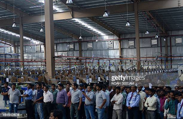 Indian employees attend the launch of Flipkart's Largest Fulfillment Centre on the outskirts of Hyderabad on October 30 2015 Flipkart is a leading...