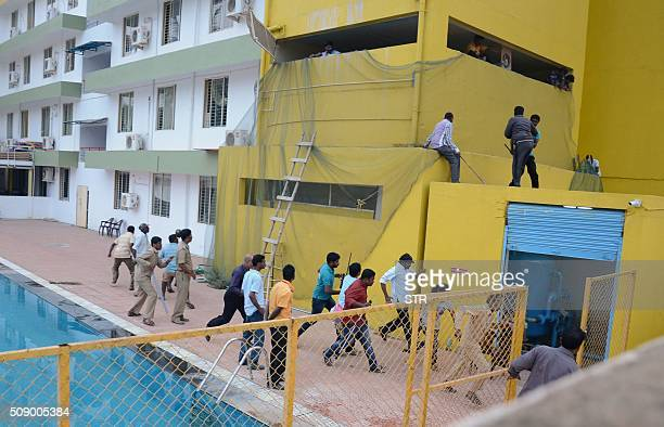 Indian employees of a private school on the outskirts of Bangalore run away following a leopard attack on February 7 2016 The animal reportedly...