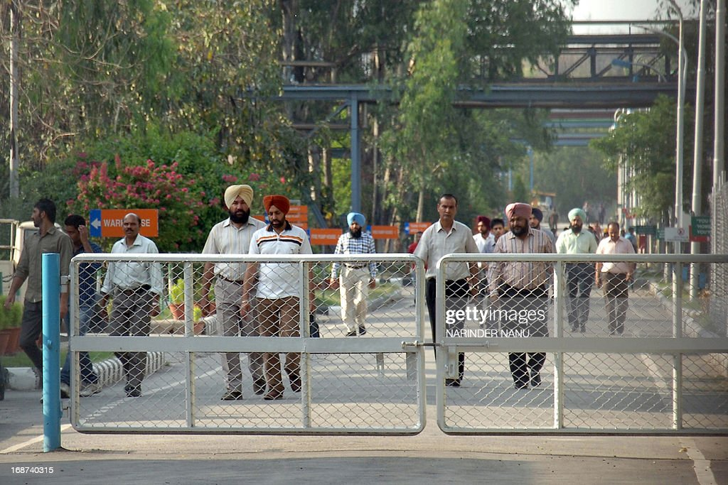 Indian employees of the Ranbaxy Laboratories Limited pharmaceutical Indian factory leave work at the end of the day at Toansa village in Ropar about 50 Km from Chandigarh on May 14, 2013. The US subsidiary of New Delhi-based Ranbaxy Laboratories pleaded guilty to seven counts of felony after it distributed several India-produced adulterated generic drugs in the United States in 2005 and 2006. They were all made in a facility near Chandigarh city in northern India, which US Food and Drug Administration inspectors cited for poor record keeping and inadequate testing for the stability of the drugs over time.