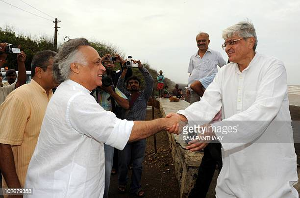 Indian Environment and Forest Minister Jairam Ramesh shakes hands with chairman of the Dandi Memorial Committee Gopal Krishna Gandhi in Dandi some...