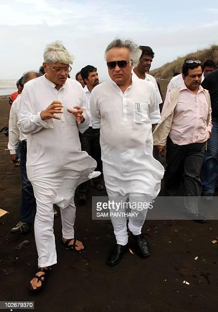 Indian Environment and Forest Minister Jairam Ramesh speaks with chairman of the Dandi Memorial Committee Gopal Krishna Gandhi on a beach in Dandi...