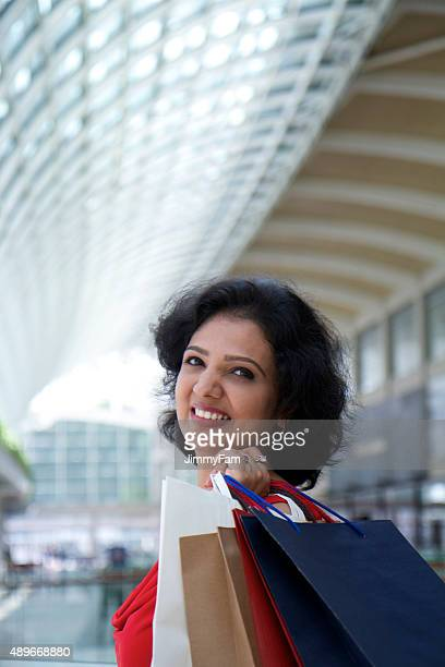 Indian ethnicity woman shopping in mall