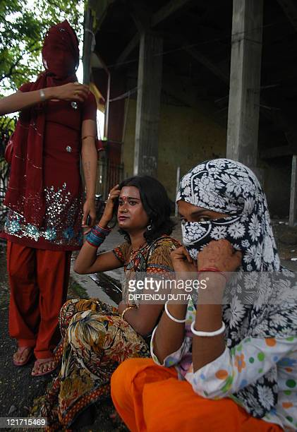 Indian eunuchs and transgender pose prior to a press briefing in Siliguri on August 22 2011 The Darjeeling District Legal Aid Forum a nongovernmental...
