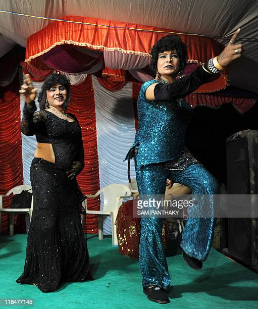 Indian eunuchs dance during a wedding reception in Ahmedabad on July 12 2009 In the presence of some one hundred eunuchs of the association a wedding...