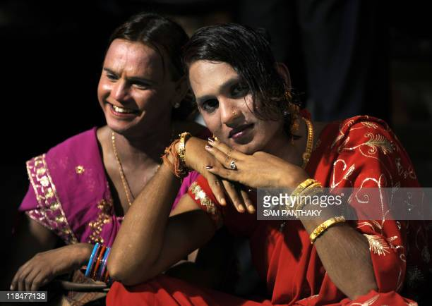 Indian eunuchs pose during a eunuch wedding reception in Ahmedabad on July 12 2009 In the presence of some one hundred eunuchs of the association a...