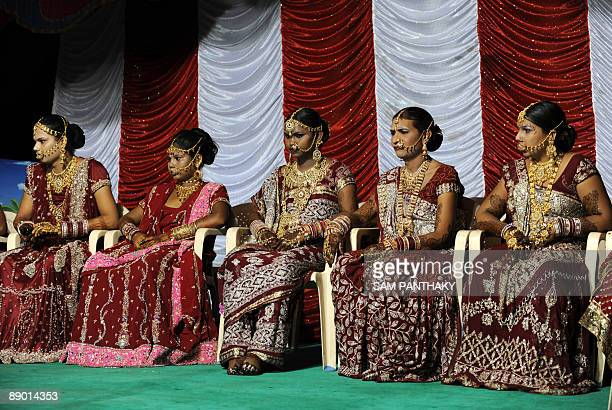 Indian eunuchs sit on a dias during their wedding reception in Ahmedabad on July 12 2009 In the presence of some one hundred eunuchs of the...