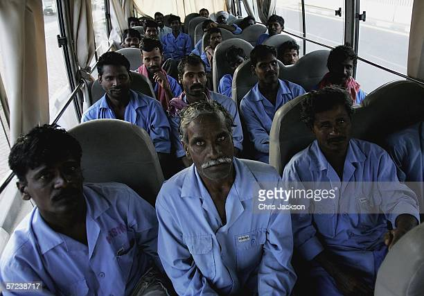 Indian expatriot construction workers from Madras travel home on a bus on April 1st 2006 in Dubai United Arab Emirates Nearly all of the constuction...