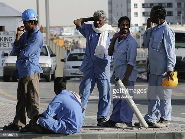 Indian expatriot construction workers from Madras wait to travel home on April 1st 2006 in Dubai United Arab Emirates Nearly all of the constuction...