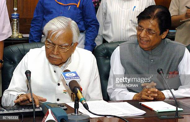 Indian External Affairs Minister Natwar Singh is watched by Minister of State for External Affairs E Ahmed as he initiates a computerised draw to...