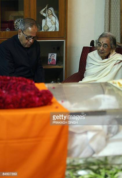Indian External Affairs Minister Pranab Mukherjee consoles Janaki wife of former president Late R Venkataraman in New Delhi on January 28 2009 Former...