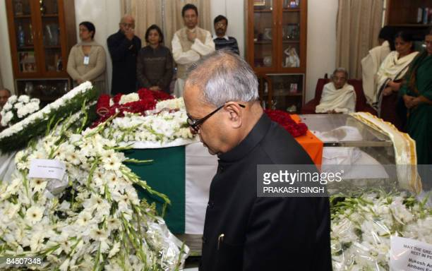 Indian External Affairs Minister Pranab Mukherjee pays homage to former president Late R Venkataraman in New Delhi on January 28 2009 Former...