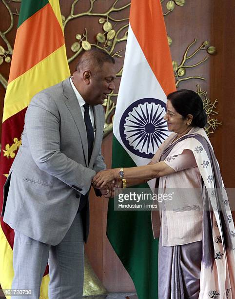 Indian External Affairs Minister Sushma Swaraj shake hands with Sri Lankan Foreign Minister Mangala Samaraweera on January 18 2015 in New Delhi India...