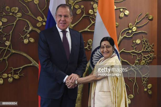 Indian External Affairs Minister Sushma Swaraj shakes hands with Russian Foreign Minister Sergey Lavrov ahead of a meeting in New Delhi on December...