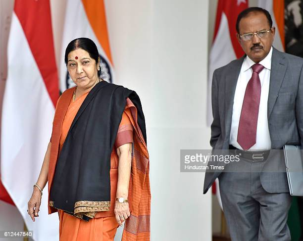 Indian External Affairs Minister Sushma Swaraj walks with National Security Advisor Ajit Doval prior to a meeting between Prime Minister Narendra...