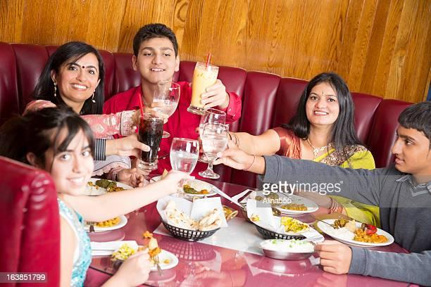 Indian family celebrating something at the restaurant