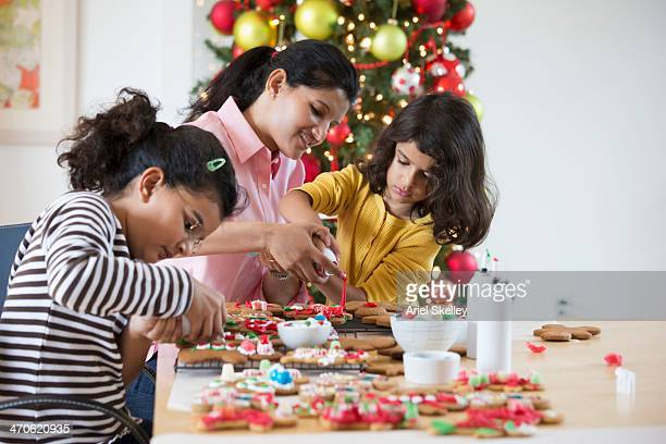Indian family decorating Christmas cookies