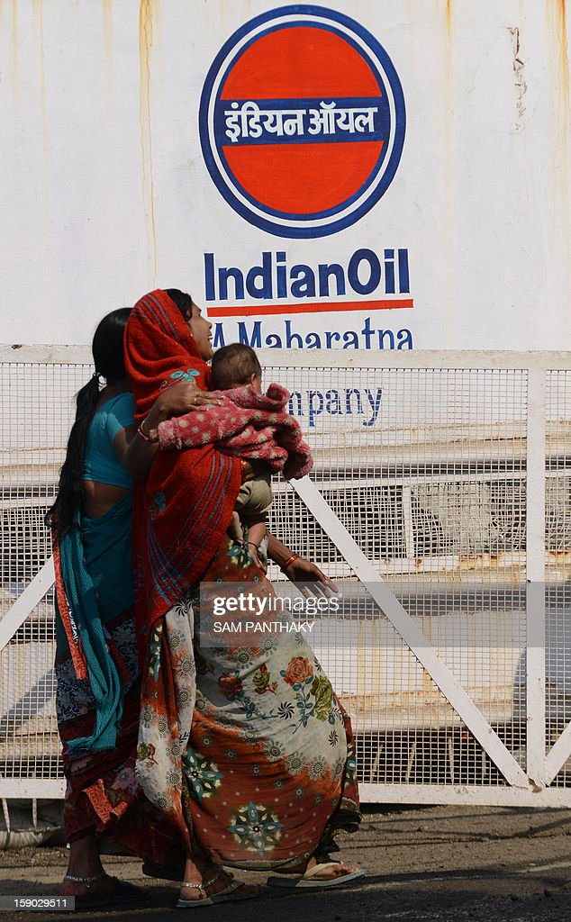 Indian family members of missing worker, Jalandhar Chaudhari react as they arrive at the Indian Oil Corporation (IOC) plant at Hajira near Surat, some 275 kms from Ahmedabad on January 6, 2013. Three persons were killed in a major fire in a storage tank of IOC terminal, which was contained after a 21-hour operation by fire brigade team, officials said according to the Press Trust of India (PTI). AFP PHOTO / Sam PANTHAKY