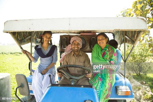 Indian family on tractor