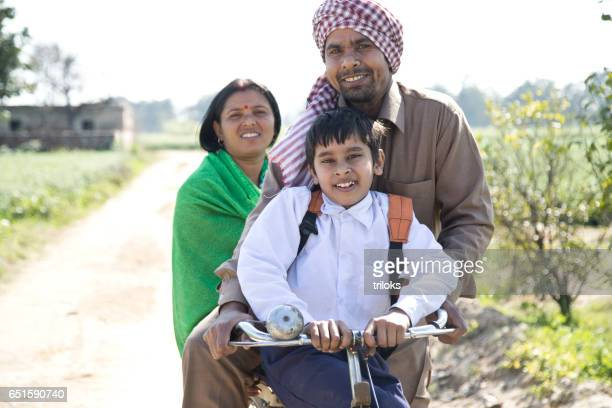 Indian family riding on bicycle