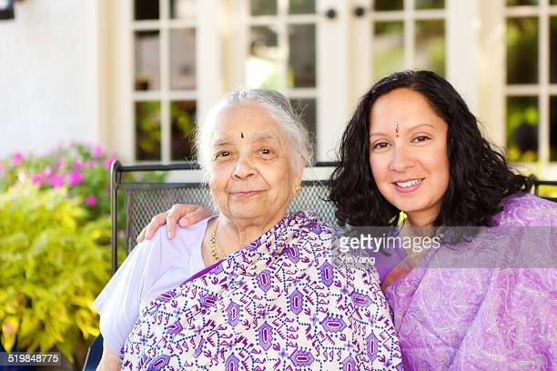 Indian Family—Daughter with Arm Around Mother on Outdoor Patio