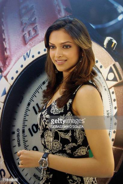 Indian famous model Deepika Padukone smiles at the inauguration of the 'Time Factory Store' in Mumbai 11 September 2006 Time Factory is an avantgarde...
