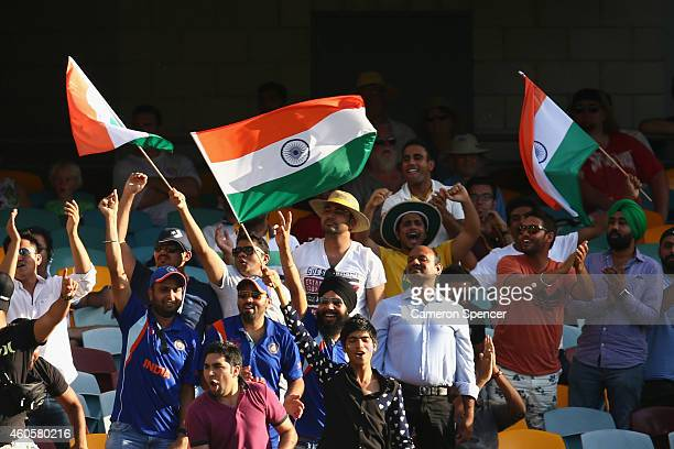 Indian fans celebrate a boundary during day one of the 2nd Test match between Australia and India at The Gabba on December 17 2014 in Brisbane...
