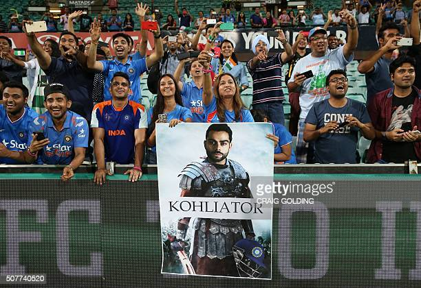 Indian fans celebrate after the third Twenty20 international cricket match between India and Australia in Sydney on January 31 2016 GOLDING