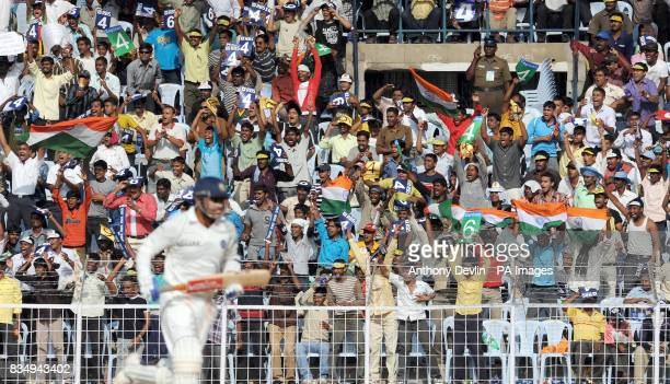 Indian fans celebrate as Virender Sehwag hits a boundary during the fourth day of the First Test Match at the M A Chidambaram Stadium in Chennai India