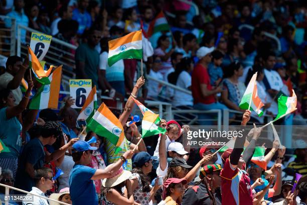 Indian fans celebrate during the T20 match between West Indies and India at the Sabina Park Cricket Ground in Kingston Jamaica on July 9 2017 / AFP...
