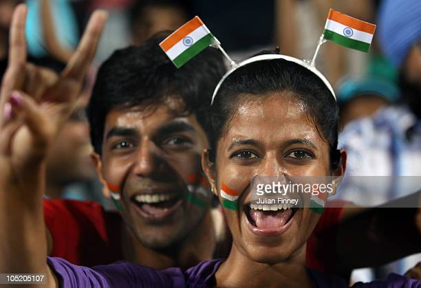 Indian fans celebrate their teams win over England during the semi final hockey match between India and England at Major Dhyan Chand National Stadium...