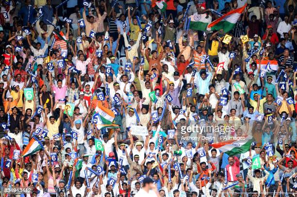 Indian fans cheer as Virender Sehwag hits a boundary during the fourth day of the First Test Match at the M A Chidambaram Stadium in Chennai India