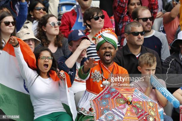 Indian fans cheer on their team during the ICC Women's World Cup cricket final between England and India at Lord's cricket ground in London on July...