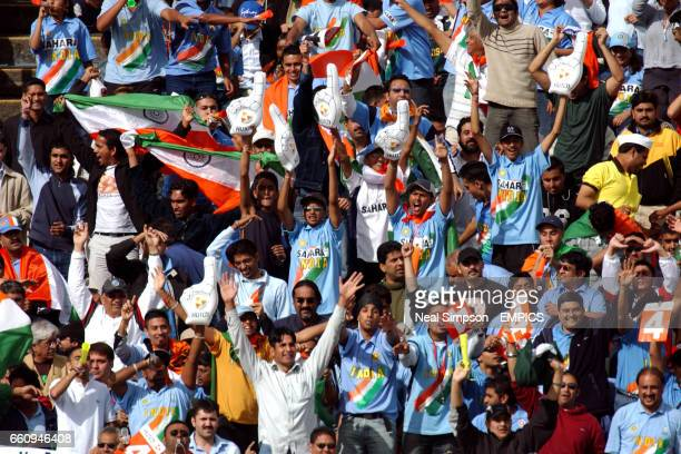 Indian fans cheer on their team
