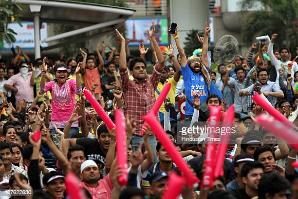 Indian fans enjoying India vs Australia Cricket World cup semifinal match at Select City Walk mall on March 26 2015 in New Delhi India Australia...