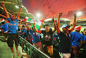 Indian fans in the crowd celebrate as a Pakistan wicket falls during the 2015 ICC Cricket World Cup match between India and Pakistan at Adelaide Oval...